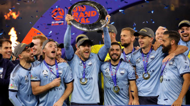 Sydney FC players celebrate after beating Perth Glory in May to win the the A-League grand final, the last to be held under the control of the FFA.