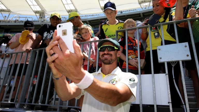 Smile: Mitchell Starc takes a selfie with young fans after the clinical finish in Perth.
