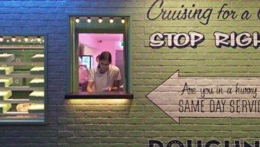 Freya Fraser working at a Doughnut Time store in East Brisbane before she was sacked.