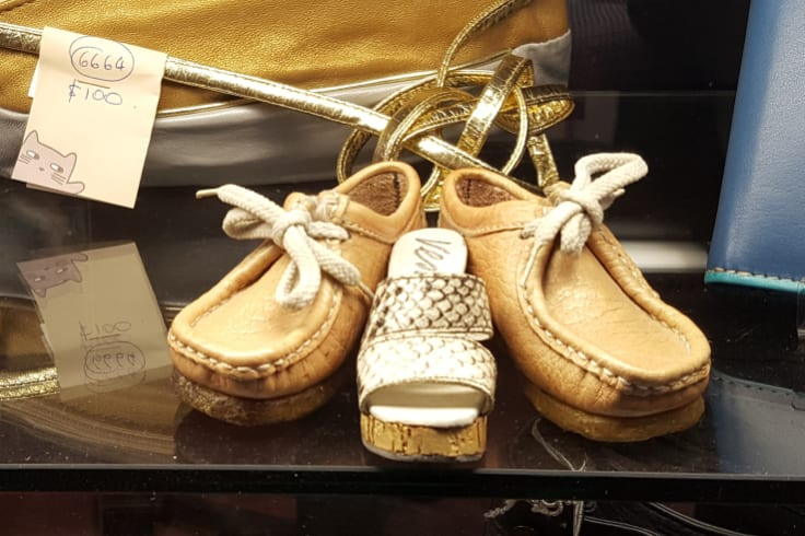 Miniature Sioux moccasins on sale at Schumacher Shoes, which will close at the end of this financial year after decades in Flinders Lane.