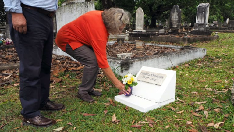 Carmel Searle laying flowers on the grave of her great-great-grandfather.