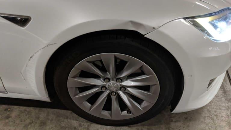 More damage to the Tesla.