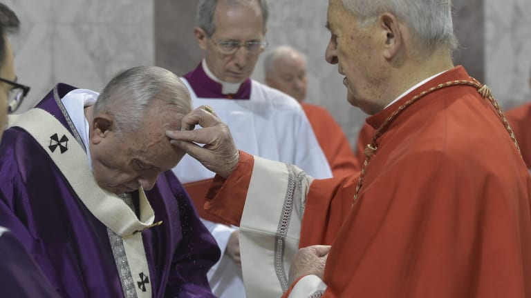 Cardinal Jozef Tomko puts ashes on Pope Francis' forehead, at the Basilica of Saint Sabina in Rome.