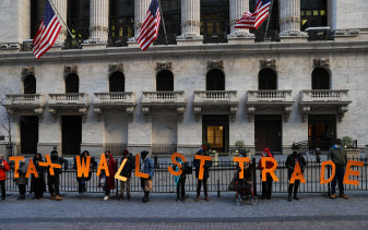 The game is rigged: Protesters outside the New York Stock Exchange on Wall Street.