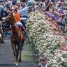 Asterisk on spring carnival crowds leaves door ajar