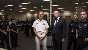 Rear admiral Lee Goddard and home affairs minister Peter Dutton during a visit to the Australian Border Force headquarters in Canberra in 2019.