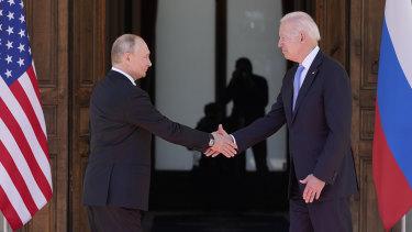Russian President Vladimir Putin and US President Joe Biden shake hands before meeting in Geneva, Switzerland.