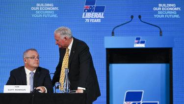 Nick Greiner speaks to Prime Minister Scott Morrison at the Hyatt Hotel in Canberra on Friday.