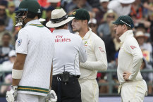 Cameron Bancroft talks to the umpires as he is sprung with sandpaper in Cape Town.