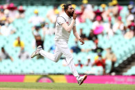 Mohammed Siraj celebrates taking Warner's wicket early on day one.