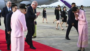 Australian Prime Minister Scott Morrison is greeted upon his arrival in Bangkok.
