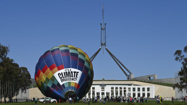 A climate change rally sets up outside Parliament House on Tuesday.
