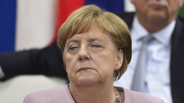 German Chancellor Angela Merkel reacts during the Leader's Special event on Women's Empowerment at the G20 summit.