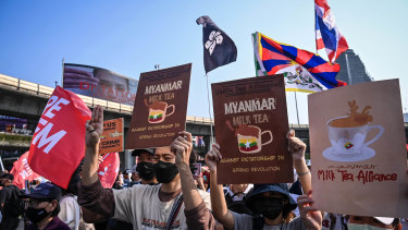 "Protesters demonstrating in solidarity with Myanmar's anti-coup movement carry ""Milk Tea Alliance"" placards in Bangkok."