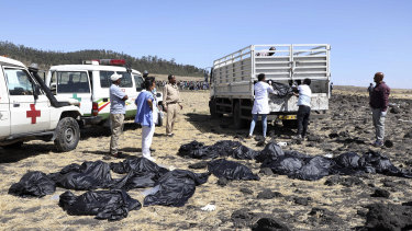 Rescuers remove body bags from the scene of an Ethiopian Airlines flight that crashed shortly after takeoff south of Addis Ababa, in Ethiopia.