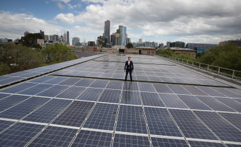 Cr Nick Reece atop a huge solar array at the University of Melbourne.