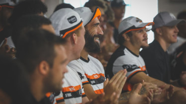 Wests Tigers players cheer the news of David Nofoaluma's re-signing on Thursday