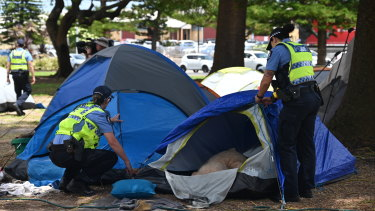 Police take down the tents at the homeless camp in Fremantle's Pioneer Park.