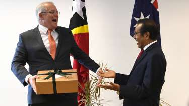 Australian Prime Minister Scott Morrison and Prime Minister of East Timor Taur Matan Ruak exchange presents at the end of a bilateral meeting in Dili.
