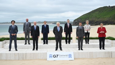 World leaders pose for the traditional G7 'family photo' in Carbis Bay. (L-R) Canadian Prime Minister Justin Trudeau, President of the European Council Charles Michel, US President Joe Biden, Japanese Prime Minister Yoshihide Suga, British Prime Minister Boris Johnson, Italian Prime Minister Mario Draghi, French President Emmanuel Macron, President of the European Commission Ursula von der Leyen and German Chancellor Angela Merkel. Australian Prime Minister Scott Morrison is a guest of G7, but Australia is not in the core group.