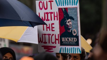 A placard at the Don't Kill Live Music rally depicts NSW Premier Gladys Berejiklian as a witch.