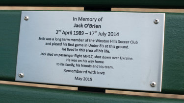 The plaque to Jack on a park bench at his team's ground.