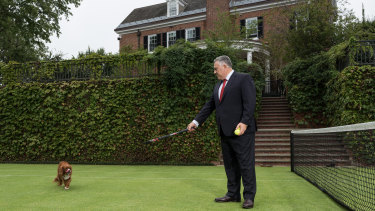 Joe Hockey on the tennis court at the ambassador's residence.