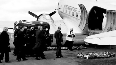 The coffin of Prime Minister Ben Chifley is loaded onto an aircraft in Canberra on 16 June 1951, headed for Bathurst,  NSW for his funeral the following day.