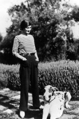 Coco Chanel at  La Pausa in Roquebrune, on the French Riviera, with her dog, Gigot.