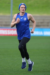 Adam Treloar running on Tuesday.