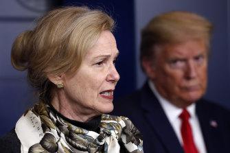 Former president Donald Trump listens as Dr Deborah Birx, White House coronavirus response co-ordinator, speaks in April.