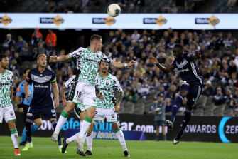 Victory's Thomas Deng, right, heads for goal.
