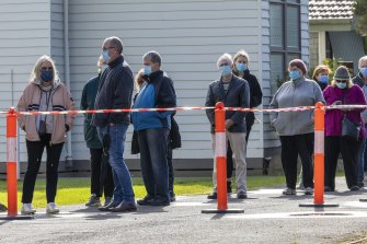 Phillip Island residents wait to be tested for coronavirus at the St Philips Anglican Church.