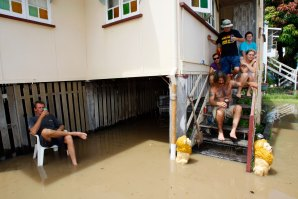 January, 2011: Residents in Rockhampton's Depot Hill district continue their New Year's celebrations surrounded by rising floodwaters.