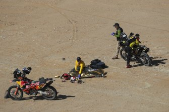 Paulo Goncalves is covered with a blanket after his fatal crash at the Dakar Rally.