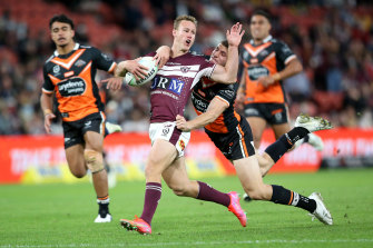Daly Cherry-Evans is tackled at Suncorp.