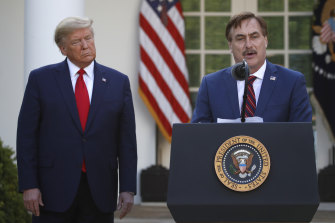 My Pillow CEO Mike Lindell speaks as then-president Donald Trump listens in 2020.