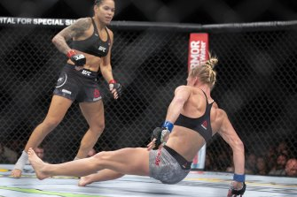 Down and out: Amanda Nunes, left, knocks out Holly Holm with a kick in the first round of their bantamweight contest.