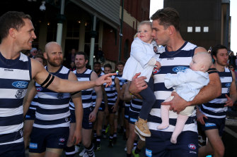 Tom Hawkins with his daughters before game 250 in 2019.