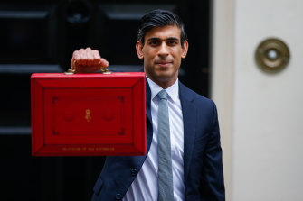 Chancellor of the Exchequer Rishi Sunak with the traditional red dispatch box containing his budget speech.