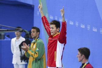 Sun Yang celebrates his Rio victory over Chad Le Clos (left).