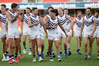 Michael Walters and the Dockers celebrate their first win of the season.