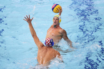 Aaron Younger is challenged by Croatia's Luka Loncar.