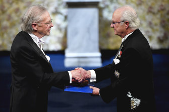Austrian author Peter Handke, left, receives the 2019 Nobel Prize from King Carl Gustaf of Sweden, during the Nobel Prize award ceremony at the Stockholm Concert Hall.