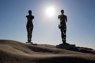 Egor Zigura's work, 'Kore that Awakening' and 'Colossus Awakening' at Sculpture by the Sea.