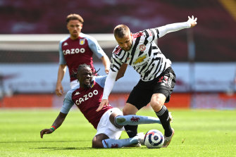 Luke Shaw of Manchester United is tackled by Villa's Bertrand Traore.