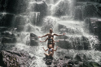 Rikki-Lee Rial and her daughters posing at Kato Lampo waterfall.