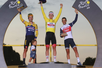 Tour de France winner Tadej Pogacar on the top step with Primoz Roglic (left) and Richie Porte (right).