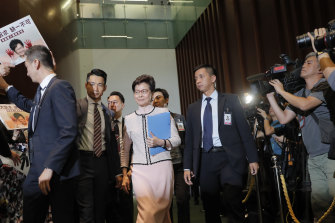 Hong Kong chief executive Carrie Lam is greeted by protesting politicians as she arrives in Parliament.