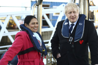 Britain's Home Secretary Priti Patel with Prime Minister Boris Johnson aboard a security boat in the Port of Southampton during election campaigning in 2019.